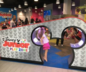 Kids can walk through a pair of Mickey ears to enter the play space.