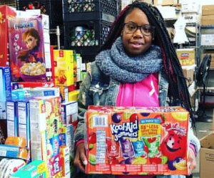 Girl poses with donated items at The INN