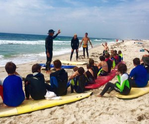 Kids taking surf lessions on the East End of Long Island