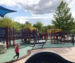 Girl running through Jake's Place playground