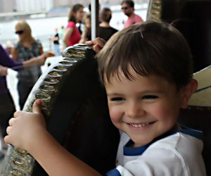 It's all smiles at Jane's Carousel in Brooklyn Bridge Park. Photo by Megan Newhart