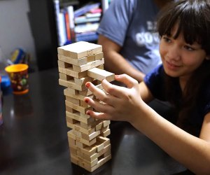 Pull out a block, place it on top but don't let the tower fall in the fun and challenging Jenga.