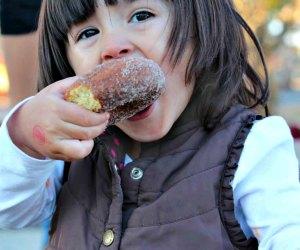 Enjoy an apple cider doughnut during your apple picking trip to Johnson's COrner Farm