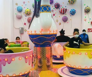 Kanga's Indoor Play Center Masked kids on Teacup Ride NYC Indoor Play Spaces