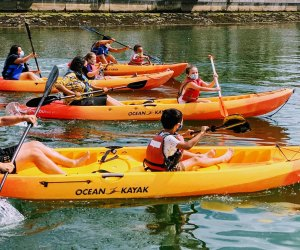 Kids learn to kayak and sail this summer. Photo courtesy of Piers Park Sailing Center