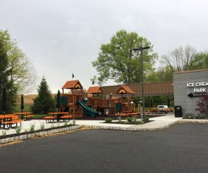 Playground and outdoor dining area at Char Burger