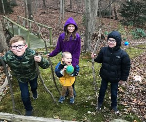 Hiking Games for Kids That Turn Walks into Adventures: kids on a hike carrying walking sticks
