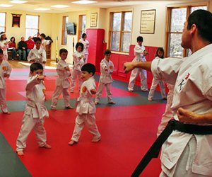 Karate classes at Ki Martial Arts increase flexibility, balance, and strength, add add to a child's confidence.