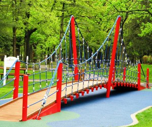 The climbing bridge at the LATCP playground at Eisenhower Park is a draw for kids of all ages. Photo courtesy of Let All The Children Play