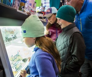 Emma's Lake Placid Creamy kids looking at treats  Things to Do in Lake Placid on a Winter Vacation Status message