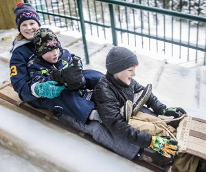 The 30-foot high Lake Placid Toboggan Chute sends riders down an ice-covered slide onto frozen Mirror Lake.