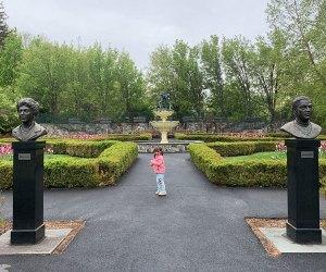 Little girl in landscaped garden at Lasdon Park & Arboretum