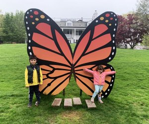 Kids posing with giant butterfly at Lasdon Park & Arboretum