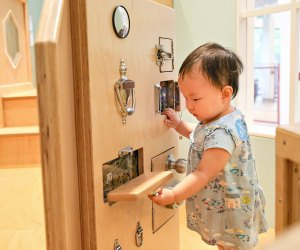 Discover the Latch Wall in the Brain Building Together space for 0-3 year olds. Photo courtesy of Discovery Museum