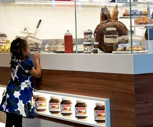 Marvel at the Nutella treats being prepared behind the counter.