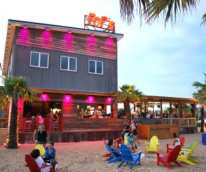 Enjoy the tropical island atmosphere and outdoor seating at Pop's Seafood Shack and Grill in Island Park.