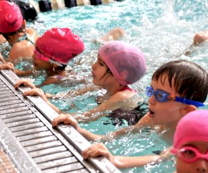 Kids learn to swim for free through NYC Parks.