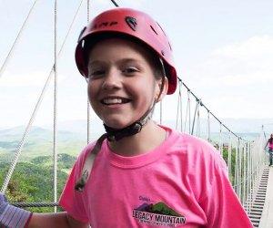 child walking across a sky bridge