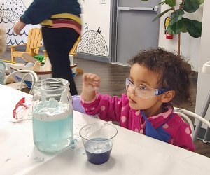 Little chemists experiment at Little Seeds Play Space. Photo by Lauren Saunders