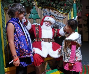 Kids can opt to pose with Santa solo or with parents. Photo by Diane Bondareff