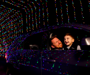 The one-mile long Magic of Lights drive-thru features glowing tunnels and digital animation.