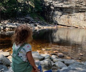 Little girl admires a view of Awosting Falls