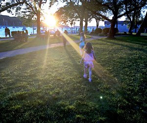 See the sunset over the water at Northport Harbor