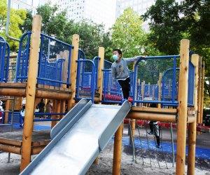 boy at top of slide