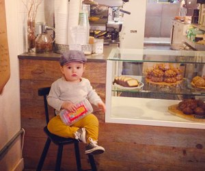 Little boy sitting at pastry counter at Moss Cafe