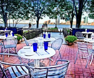 Merchants River House backyard patio dining overlooking water
