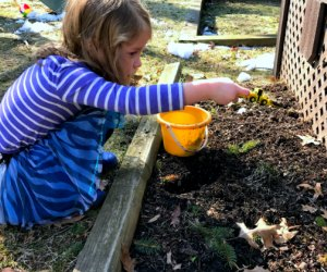 Hand them a pail and a spoon, er, shovel, and let kids dig in the dirt.