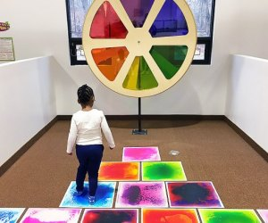 Girl explores the color wheel at Imagine That!