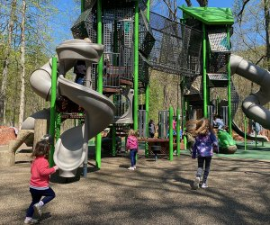 The towering new playground structure at Nomahegan Park packs tons of fun with its twisty slides, wobbly bridge, and tons of challenging climbing structures.