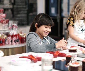 girl decorating desserts at a cooking class