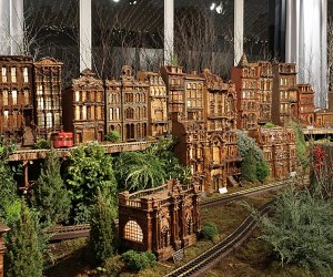 Marvel at model trains zipping through an enchanting display of more than 175 famous New York landmarks at the Holiday Train Show at the New York Botanical Gardens.  Photo by author