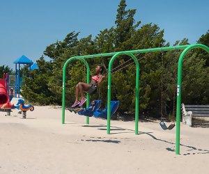 Kids play on a brach playground
