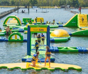 Hit the obstacle course at these inflatable Orlando water parks. Photo courtesy of The Orlando Watersports Complex
