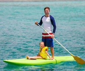 Take a paddleboard lesson. Photo via Bigstock