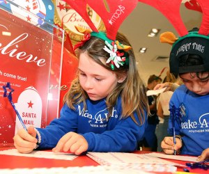 Support the work of the Make-A-Wish Foundation by having your child write a letter to Santa and deliver it to the mailbox in Santaland. For every letter Macy's receives, the company will donate $1 to Make-A-Wish. Photo courtesy of Macy's