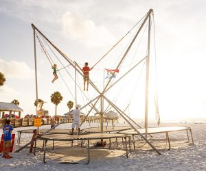 kids doing a bungee trampoline jump on the beach ni clearwater