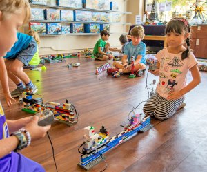 Legos become engineering tools at camp. Photo courtesy of Play-Well-TEKnologies