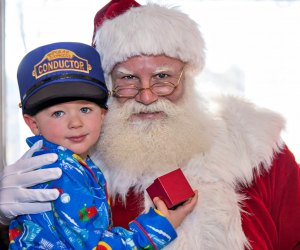 Santa brings holiday cheer (and a special gift) to each of his  young passengers. Photo by Robert Berard courtesy of Blackstone Valley Tourism Council