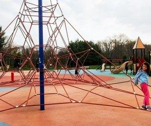 Children climb the rope tower at Ponderosa Park