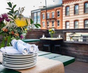 Table with plates on the rooftop patio at Porta