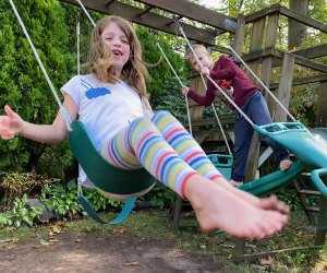 A backyard swing set becomes an obstacle course with a little creativity. Photo by Rose Gordon Sala