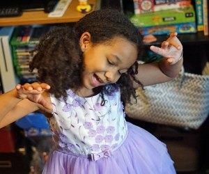 Little girl enjoys a dance break