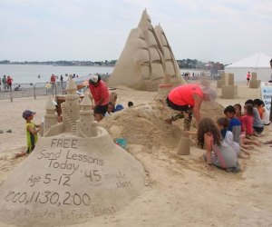 Kids get their hands sandy at the Revere Beach Sand Sculpting Festival. Photo courtesy of the Revere Beach Partnership