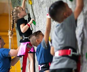 Kids conquer the climbing wall at Rockin Jump Trampoline park in Ridge Hill, New York. Photo courtesy of the park