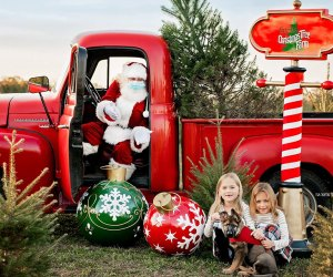 You can't miss Santa as he sits in his bright red truck at Santa's Christmas Tree Farm. Photo by Ewa Skapski Photography