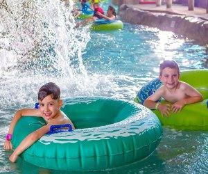 Kids float in Sahara Sam's indoor water park's lazy river